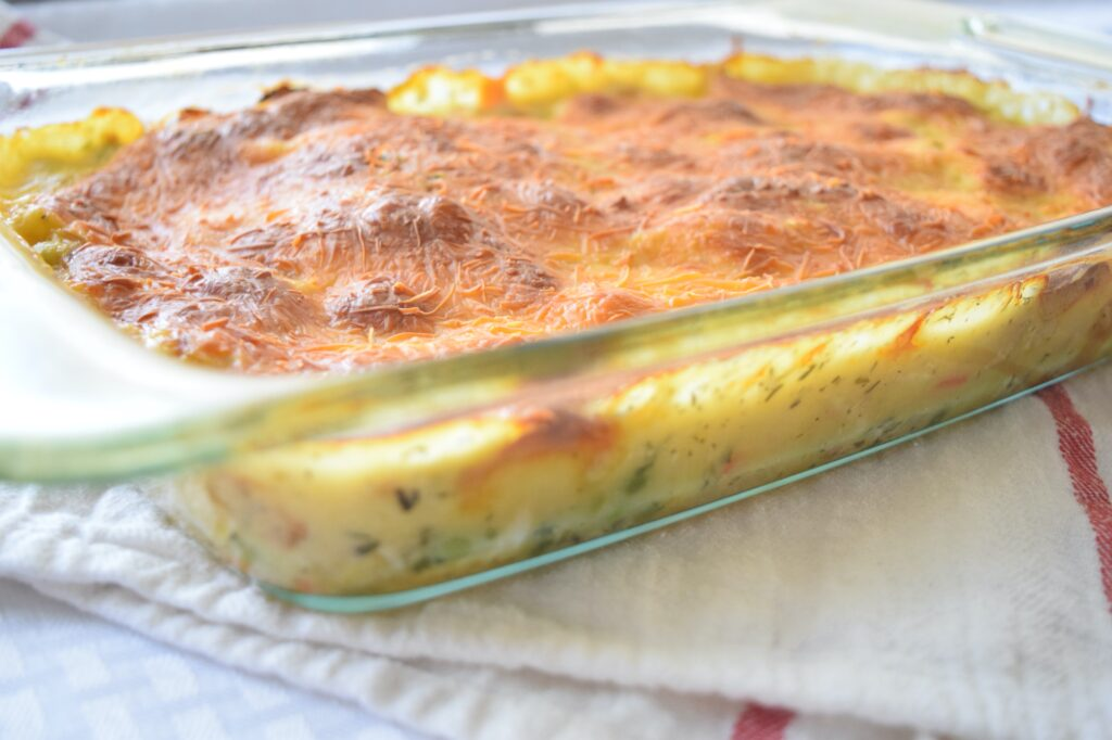 Picture of the side and creamy vegetable filling of a chicken pot pie bubble up casserole.
