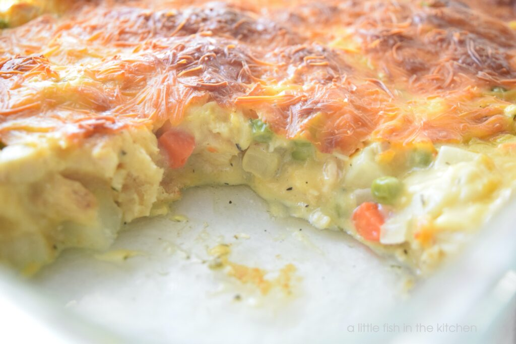 Picture of the inside of a chicken pot pie bubble up casserole with vegetables and creamy soup.