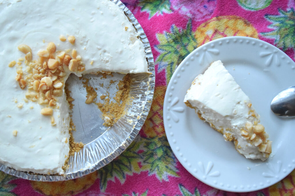 picture of a slice of creamy pineapple pie on a plate