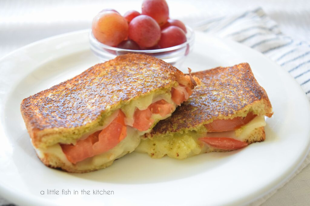 picture of sliced tomato-pesto grilled cheese