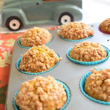 picture of pumpkin oat streusel muffins in a muffin tin